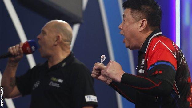 Paul Lim celebrates victory