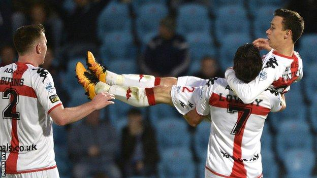 Paul Heatley gets a lift after Crusaders into a 2-1 lead against Ballymena