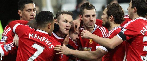 Wayne Rooney (centre) is congratulated by team-mates
