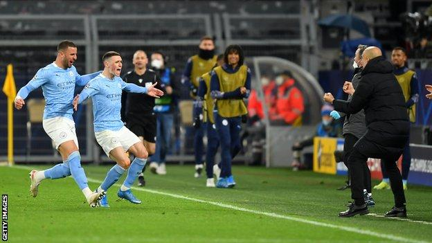 Phil Foden (second from left) celebrates his goal with manager Pep Guardiola (right)