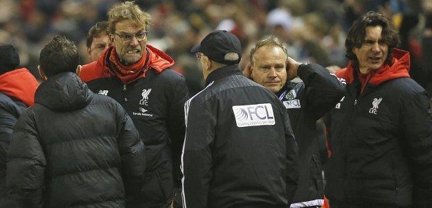 Jurgen Klopp celebrates Origi's goal and then turns towards Tony Pulis