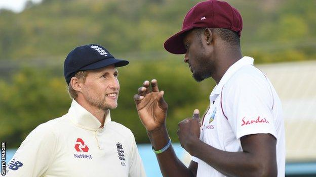 Joe Root talks to Jason Holder