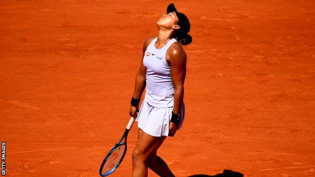 Osaka looks to the sky in frustration