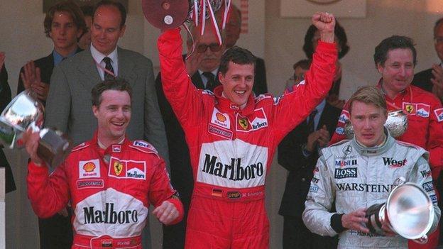 Michael Schumacher wins the Monaco Grand Prix from Eddie Irvine and Mika Häkkinen