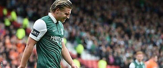 Jason Cummings looks anguished after chipping his penalty over the bar