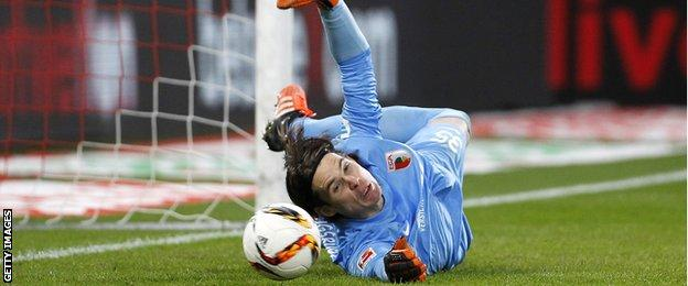 Augsburg goalkeeper Marwin Hitz saves a penalty against Cologne