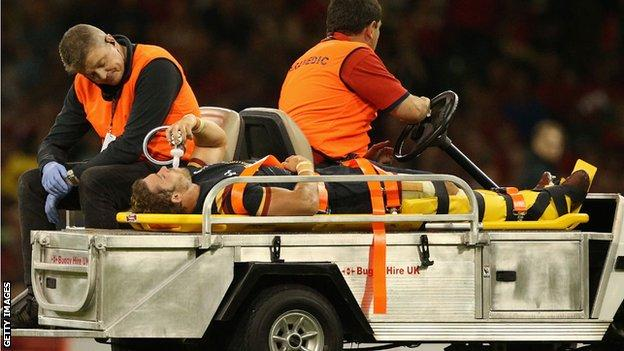 Leigh Halfpenny is carried off the field after injuring his knee