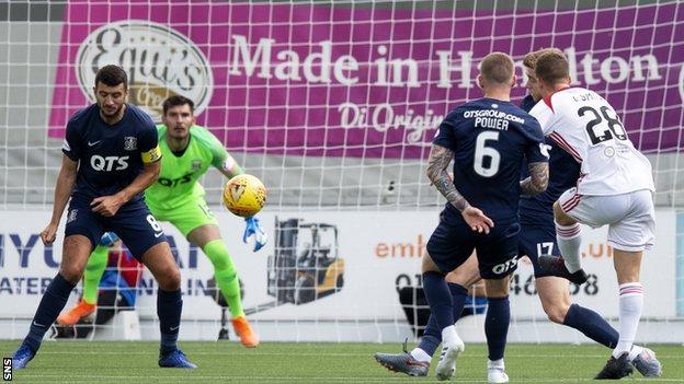 Lewis Smith scores