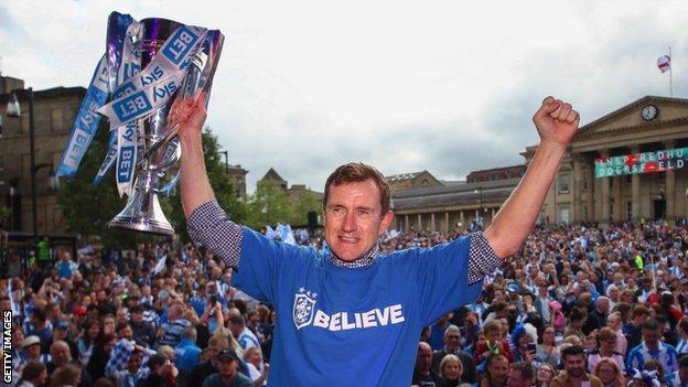 Dean Hoyle celebrates promotion to the Premier League