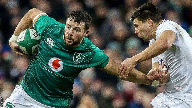 Robbie Henshaw gets a tug from England's Ben Youngs in last year's Six Nations game in Dublin