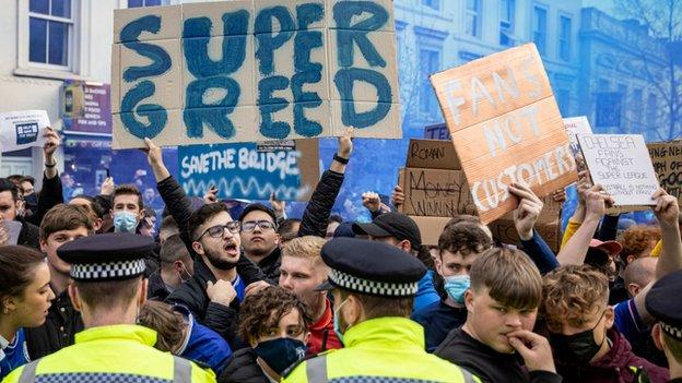 Fans protest at Chelsea on Tuesday before it was announced the six English clubs would not join a European Super League