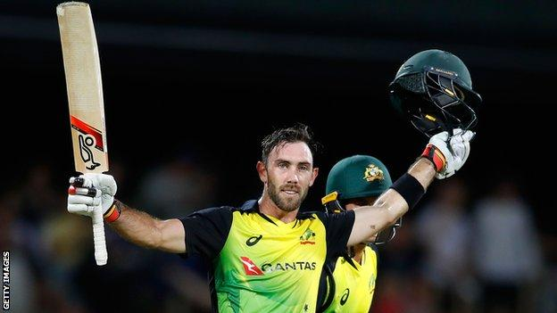 Australia's Glenn Maxwell celebrates scoring a century and winning the game against England