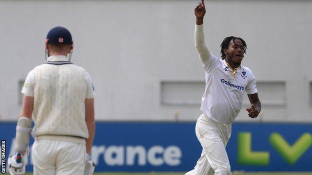 Jofra Archer celebrates taking the wicket of Zak Crawley