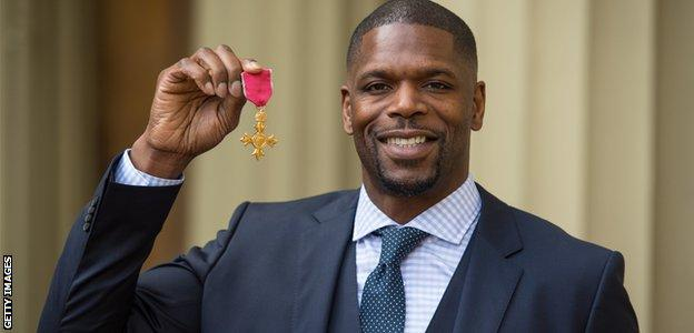 Mark Prince shows off his OBE