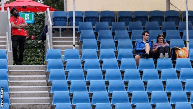 Spectators watch Ons Jabeur and Andrea Petkovic at Melbourne Park