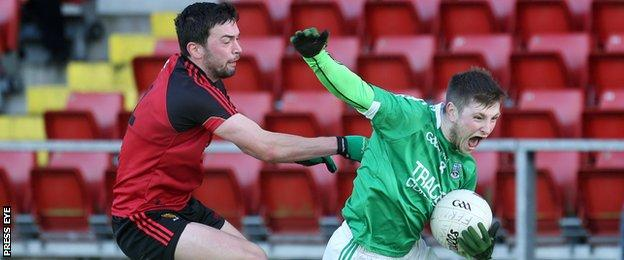 Down's Damien Turley battles with Fermanagh's Daniel Teague on Sunday at Pairc Esler