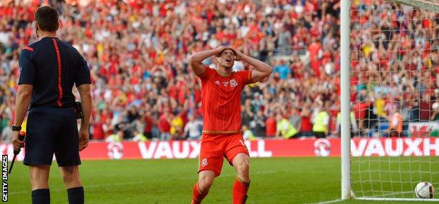 Wales substitute Simon Church reacts after having a 'goal' disallowed for offside