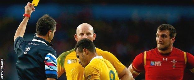 Referee Craig Joubert shows Australia scrum-half Will Genia a yellow card against Wales