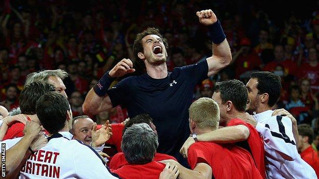 Andy Murray is hoisted into the air by his Great Britain team-mates