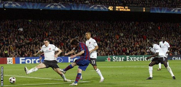 Lionel Messi scores his fourth goal against Arsenal