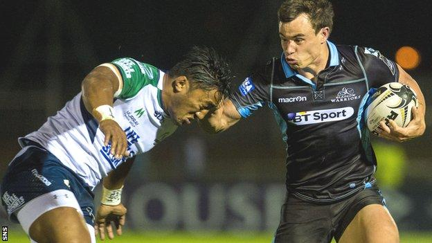 Glasgow wing Lee Jones takes on the Connacht defence when the two sides met earlier this season