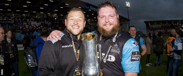 Ryan Grant and Jon Welsh celebrate with the Pro12 trophy