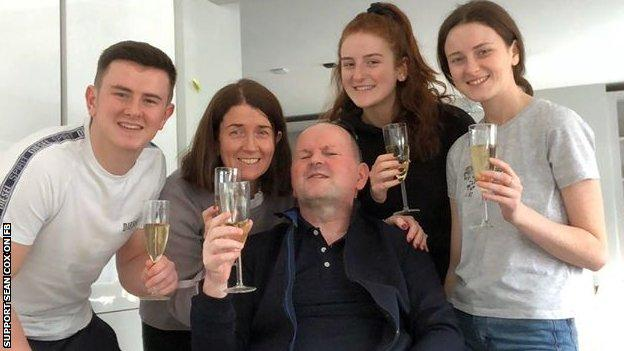 Sean Cox and his family celebrates his return home after two years of hospital treatment