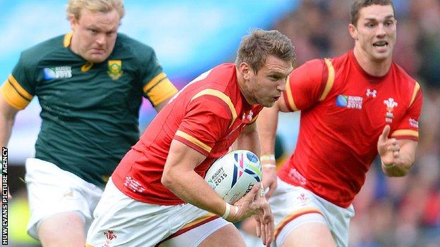 Dan Biggar makes a break for Wales against South Africa