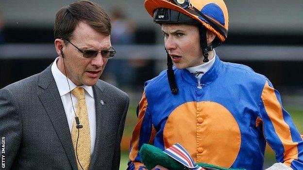 Trainer Aidan O'Brien and son Joseph talk tactics before a race