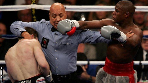 Ricky Hatton is held back by referee Joe Cortez