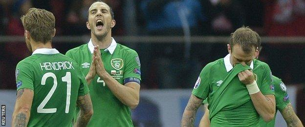Republic of Ireland players after defeat by Poland