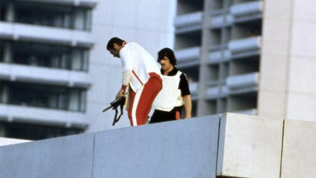 Armed police officers, disguised as Olympic competitors, on the roof of the Israeli housing, during the Munich Olympics siege, 6 Sept 1972