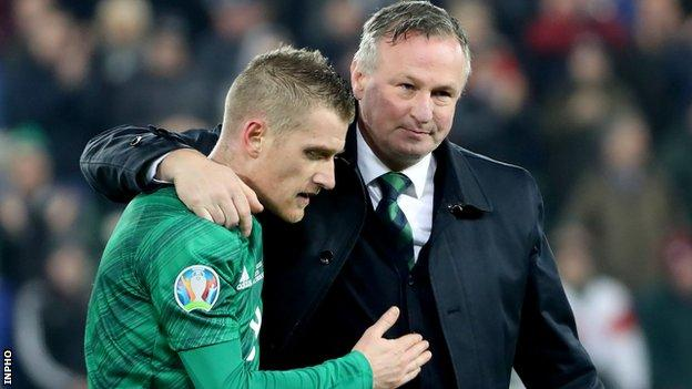 Michael O'Neill consoles Steven Davis at the final whistle on Saturday after the Northern Ireland captain's earlier penalty miss against the Dutch
