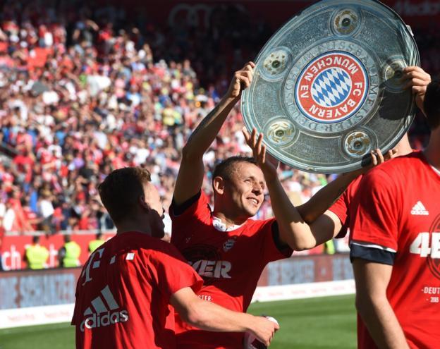 Bayern Munich players celebrate winning the Bundesliga title