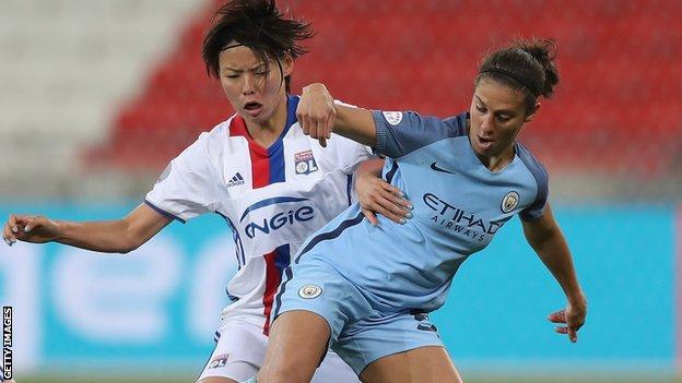 Carli Lloyd of Manchester City battles with Saki Kumagai of Lyon