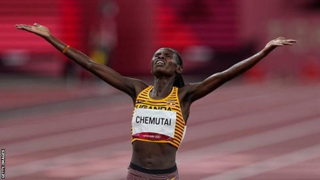 Uganda's Peruth Chemutai celebrates winning the 3,000m steeplechase gold at the Tokyo Olympics
