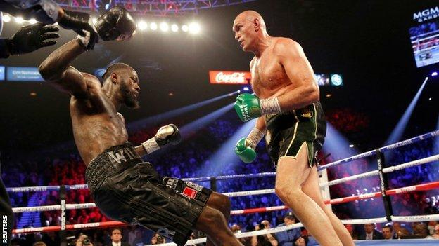 Deontay Wilder is knocked down during his second fight with Tyson Fury