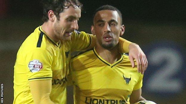 Oxford United celebrate Kemar Roofe's hat-trick against Dagenham