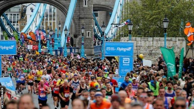 Runners heading over Tower Bridge in the 2019 London Marathon