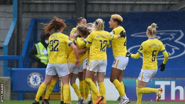 Brighton players celebrate