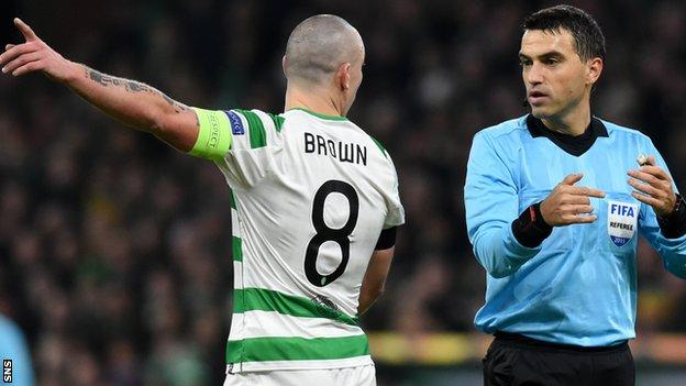 Celtic captain Scott Brown with referee Ovidiu Hategan