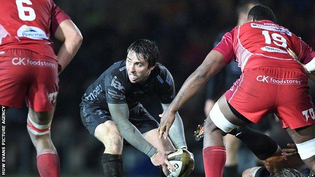 Rhodri Williams prepares to make a pass for Dragons against Scarlets