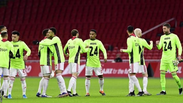 Ajax players wearing shirts in support of Cameroon goalkeeper Andre Onana