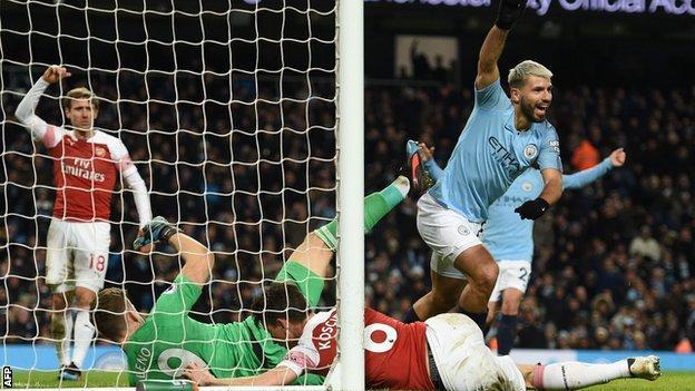 Sergio Aguero celebrates scoring for Manchester City against Arsenal