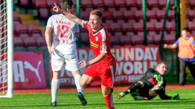 Cliftonville winger Stephen Garrett runs away in celebration after netting the first of his two goals against Portadown at Solitude