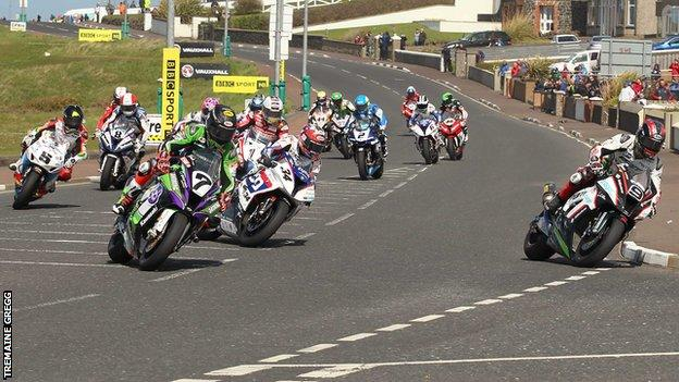 Riders approach York Corner on the Triangle Circuit at the North West 200