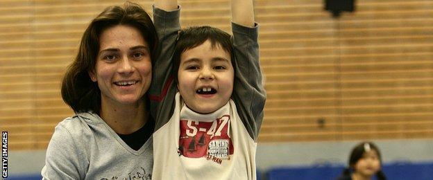 Oksana Chusovitina with her son