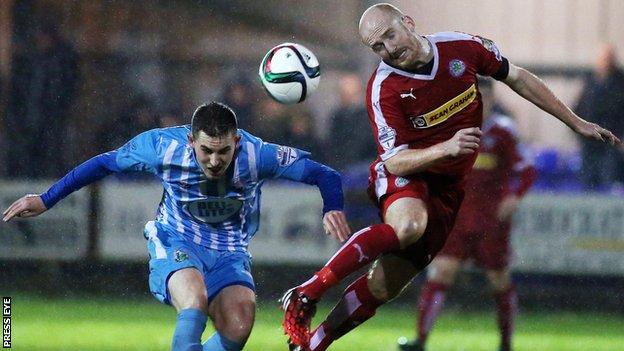 Daniel Hughes battles with Ryan Catney in Tuesday's League Cup semi-final at Milltown