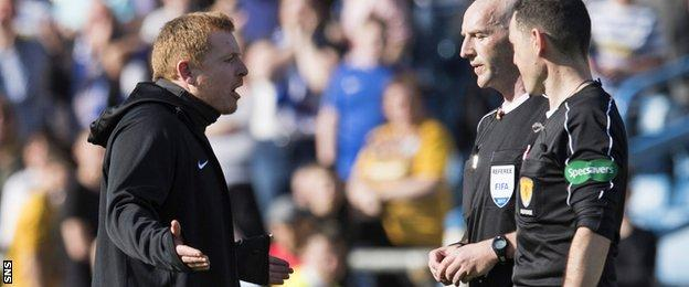 Hibs head coach Neil Lennon remonstrates with referee Bobby Madden at Cappielow