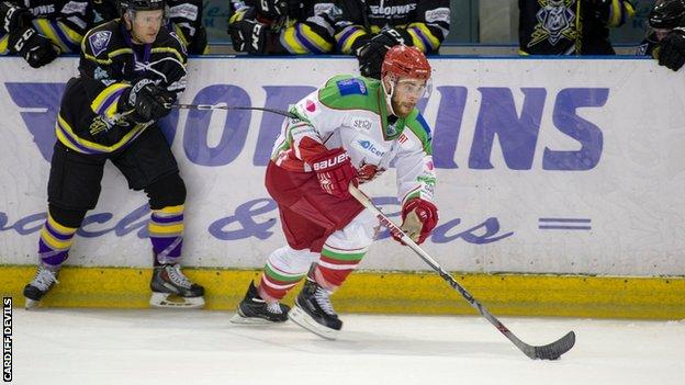 Cardiff Devils' Zach Hervato skates away from a Manchester defender